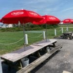 JImmy's seafood buffet exterior picnic tables with cheerwine umbrellas